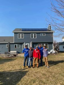 picture of siding contractor team in front of completed home